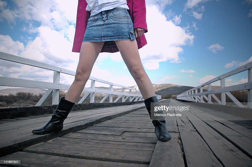 Woman legs with miniskirt : Stock Photo