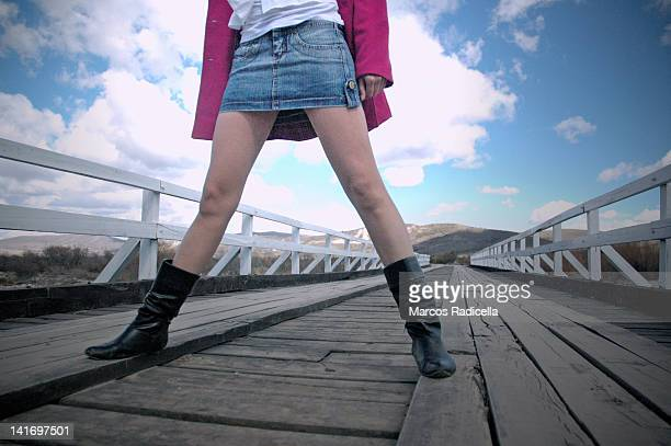 woman legs with miniskirt - radicella stock pictures, royalty-free photos & images