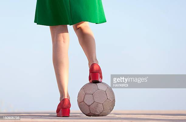 woman legs with soccer ball - kicking stock pictures, royalty-free photos & images