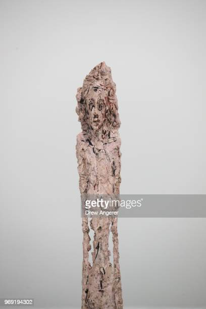 'Woman Leoni' a plaster sculpture from 194758 is displayed at a retrospective exhibition of work by Swiss sculptor and artist Alberto Giacometti at...