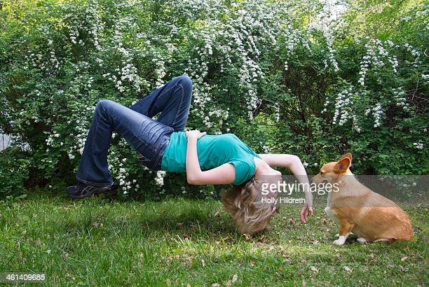 Woman levitating with dog