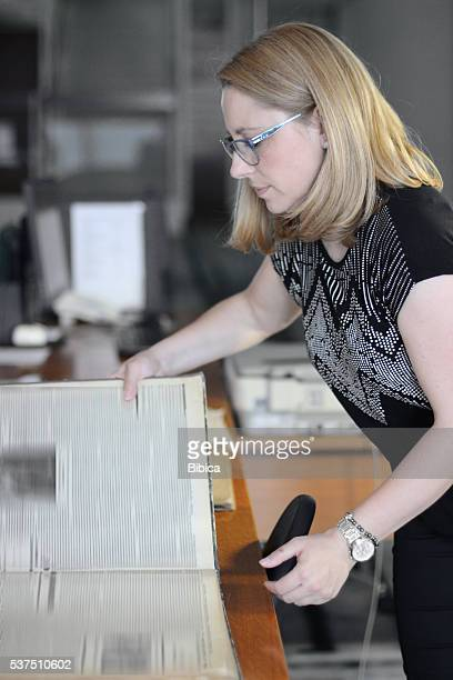 Woman Librarian scanning newspapers