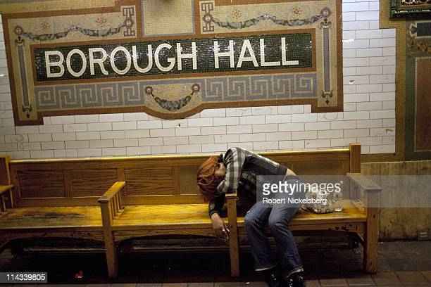 Woman lies asleep on a wooden bench at the Borough Hall subway station March 18, 2011 in Brooklyn, New York. In 2009, the New York City Subway...