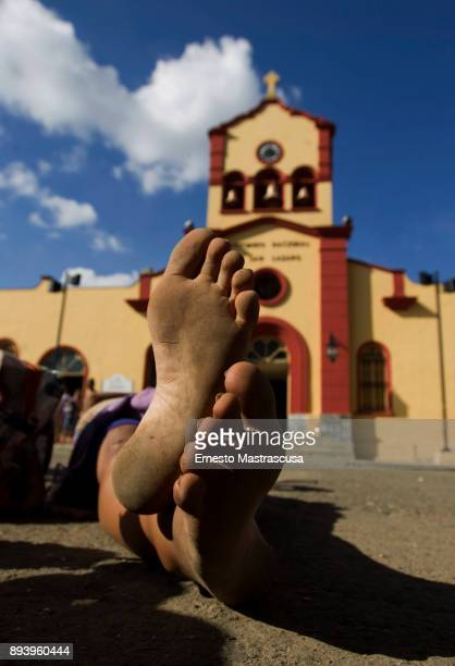 A woman lies down to fulfill a promise to San Lazaro on December 16 2017 in La Habana Cuba Thousands of believers gather at the Shrine of San Lazaro...