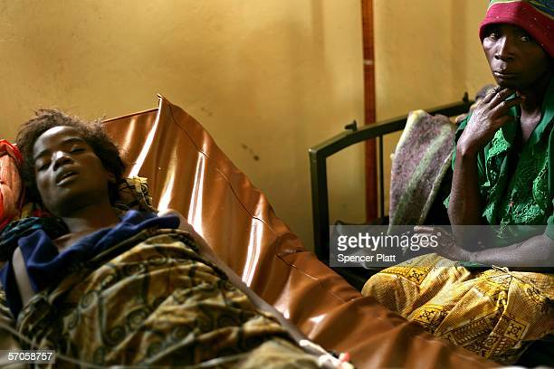 A woman lies dying of AIDS at a hospital run in conjunction with Medecins Sans Frontieres March 11 2006 in Rutchuru DR Congo The Democratic Republic...
