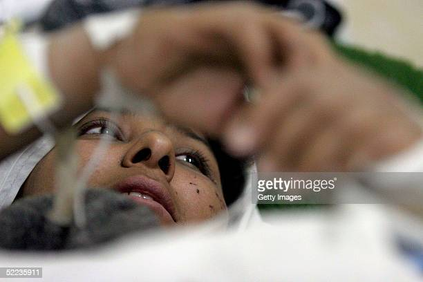 A woman lies injured in hospital for survivors on February 24 2005 in Zarand Iran The earthquake which hit 64 on the Richter scale struck February 22...