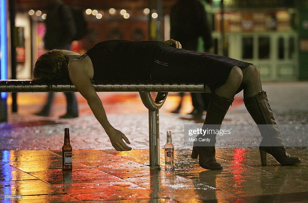 A woman lies on a bench after leaving a bar in Bristol City Centre on October 15, 2005 in Bristol, England. Pubs and clubs are preparing for the new Licensing laws due to come into force on November 24 2005, which will allow pubs and clubs longer and more flexible opening hours. Opponents of the law believe this will lead to more binge-drinking with increased alcohol related crime, violence and disorder while health experts fear an increase in alcohol related illnesses and alcoholism.