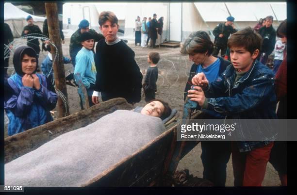 A woman lies on a stretcher at Batnaga refugee camp December 11 1994 in BosniaHerzegovina Civil war erupted in Bosnia and Herzegovina after the...