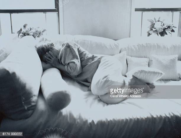 Woman Lies on Sofa Bed