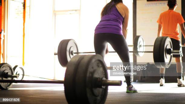 Woman lifting free weights in gym.