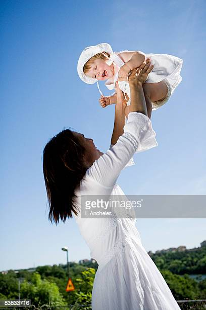 A woman lifting her daughter Sweden.