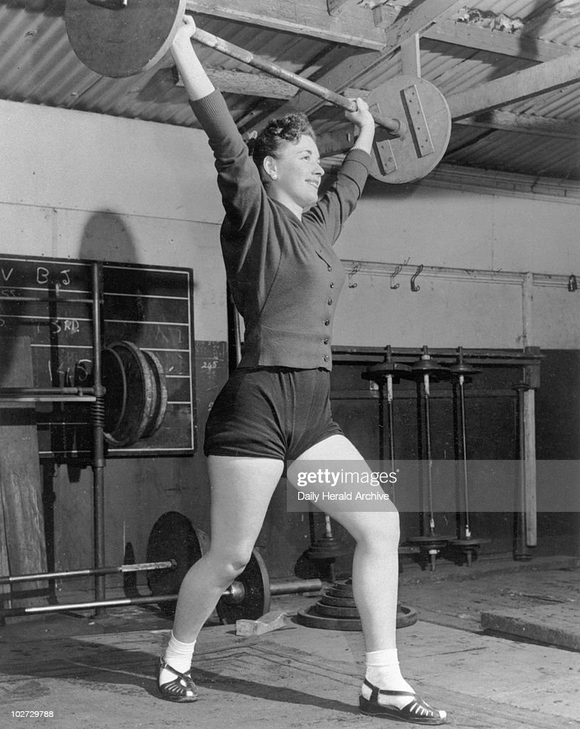 Woman lifting weights, 29 February 1956. : News Photo