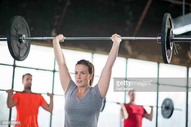Woman Lifting Weights Over Her Head