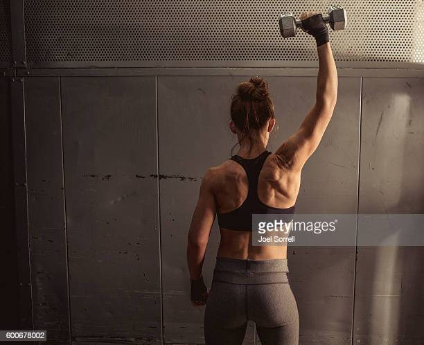 woman lifting weights - shoulder stock pictures, royalty-free photos & images