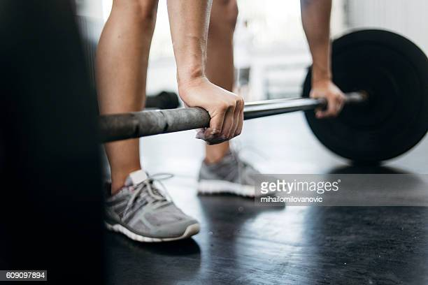 woman lifting weights - weight stock pictures, royalty-free photos & images