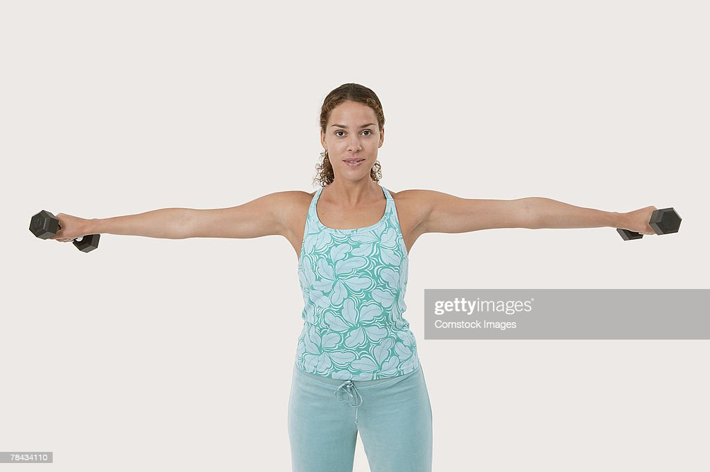 Woman lifting weights : Stockfoto