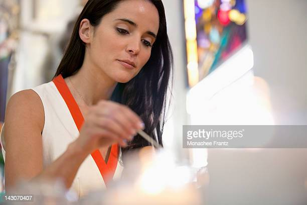 Woman lighting candles in church