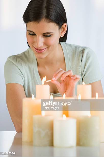 Woman lighting candles