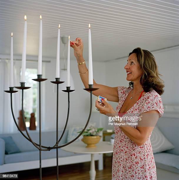 A woman lightning candles.