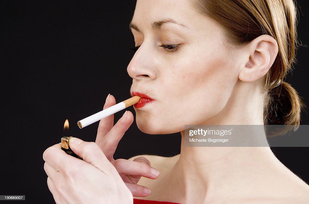Woman lights a cigarette  sc 1 st  Getty Images & Woman Lighting Cigarette Stock Photos and Pictures | Getty Images azcodes.com