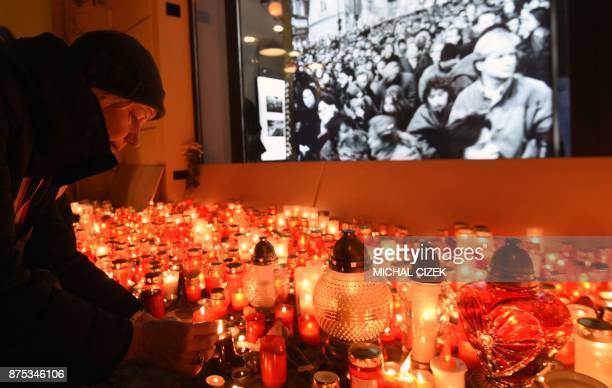 Woman lights candles to commeorate the 28th anniversary of the so-called Velvet Revolution on November 17, 2017 in Prague. The Czech Republic marked...