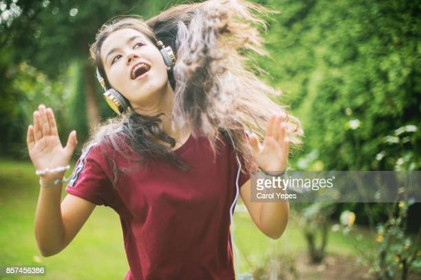 woman listen and dance with music headphones