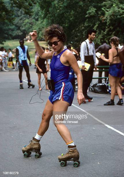 Woman listen to music on a Walkman as she roller skates in Central Park, New York City, 1988.
