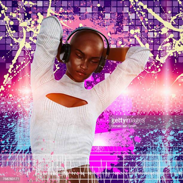 Woman listening and dancing to headphones