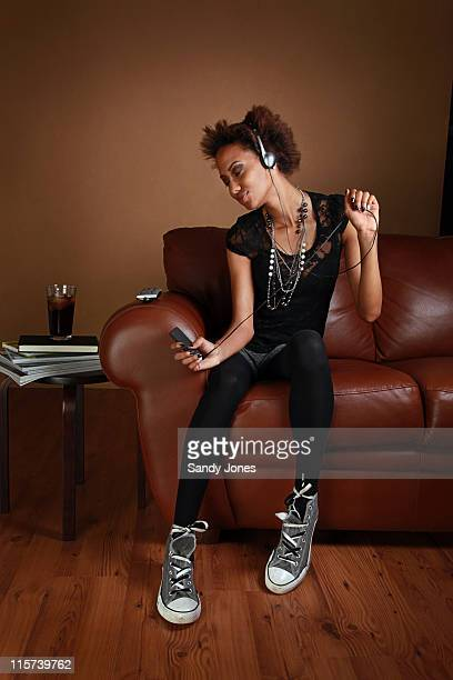Woman listening and dancing to music