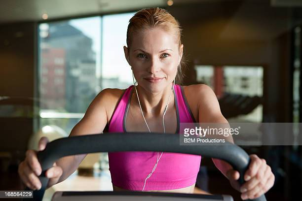Woman Listening Music Exercising In Gym