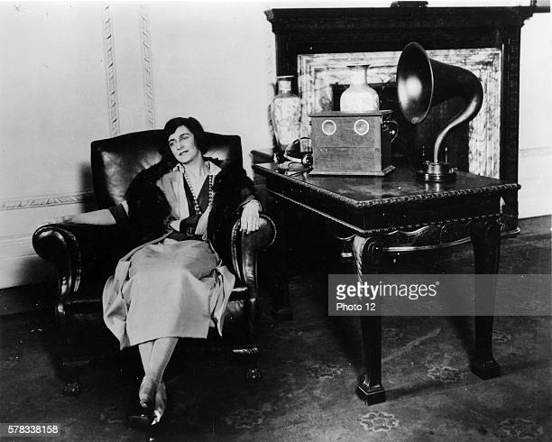 Woman listening to a Marconi speaker 1922