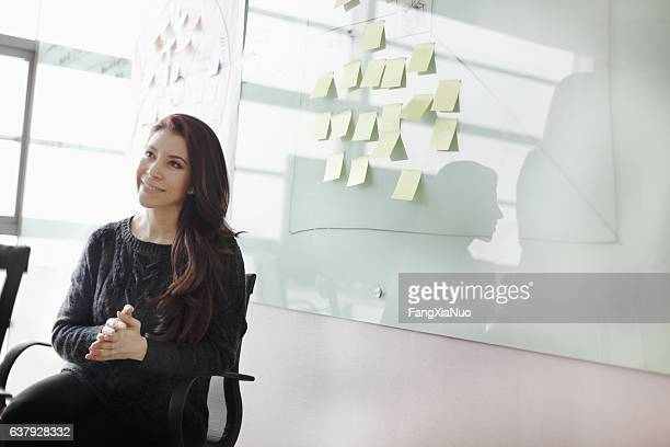 Woman listening to colleagues in studio office