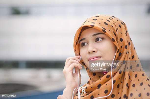 Woman listening to earphone