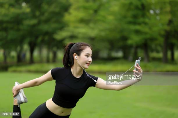 Woman listening to music and practicing yoga