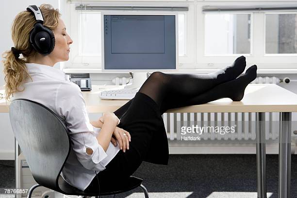 A woman listening to music at work