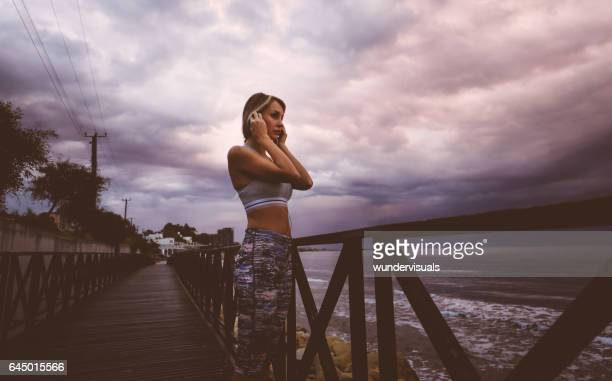 Woman listening to music during jogging exercise