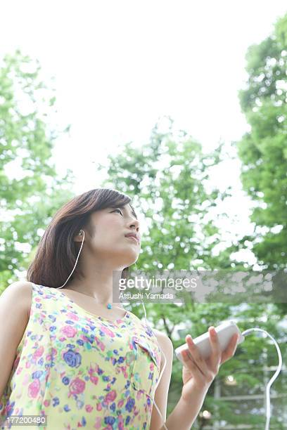 Woman listening to music in forest