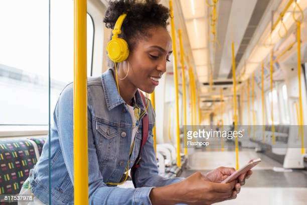 Woman listening to music on a train
