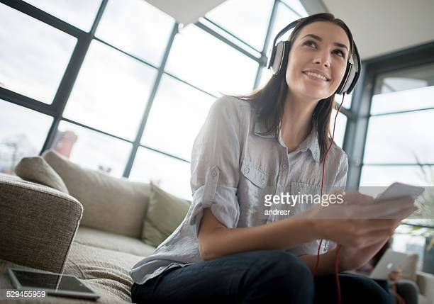 woman listening to music - radio stock pictures, royalty-free photos & images