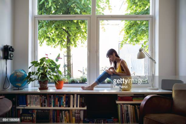 Woman listening to podcast in her beautiful house