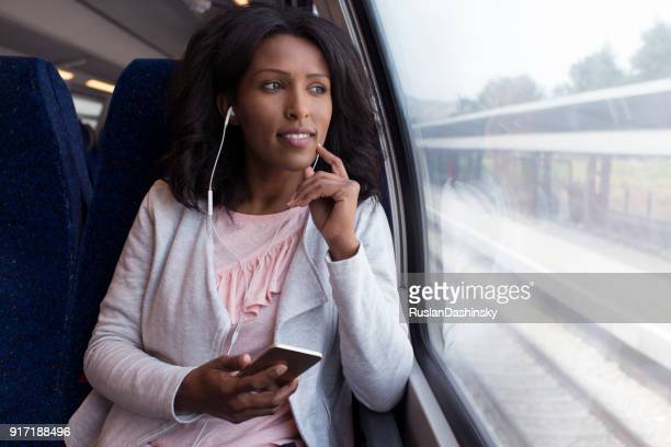 woman listening to the music on the train. - israeli woman stock pictures, royalty-free photos & images