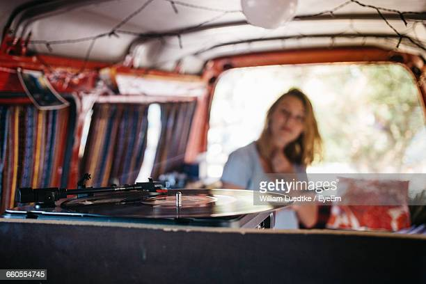 Woman Listening To Turntable