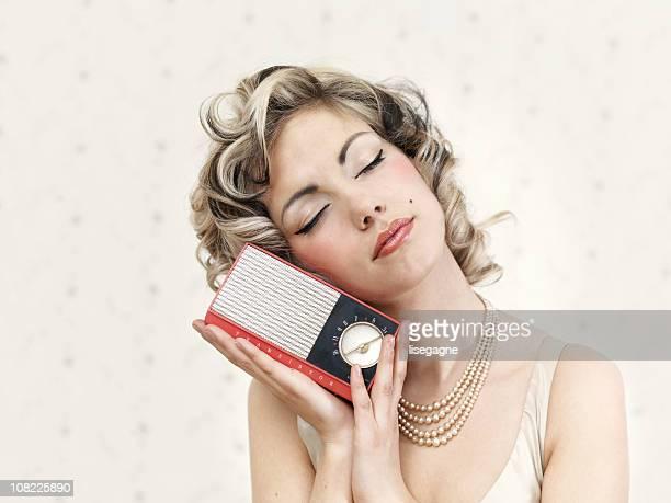 Woman Listening to Vintage Radio