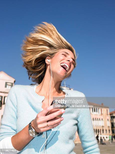 Woman listenning to mp3 player, dancing