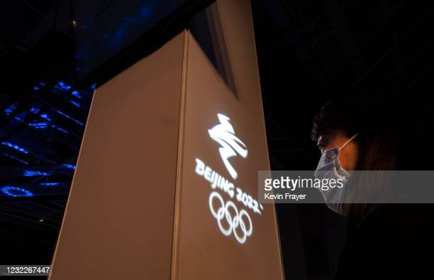 Woman listens during speeches at an event held by the organizing committee of the Beijing 2022 Winter Olympics and Paralympics for international...