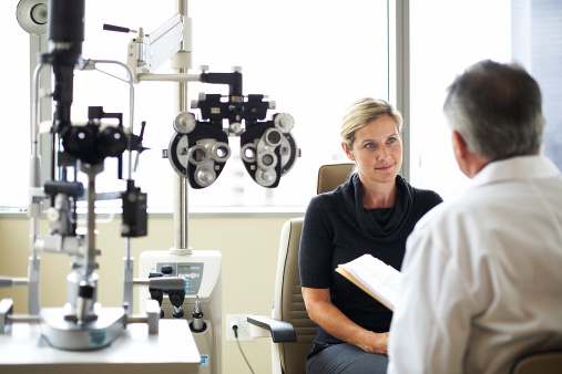 A woman listens to her opthamologist 89987853