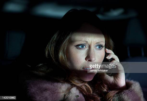 Woman listens to mobile phone in car