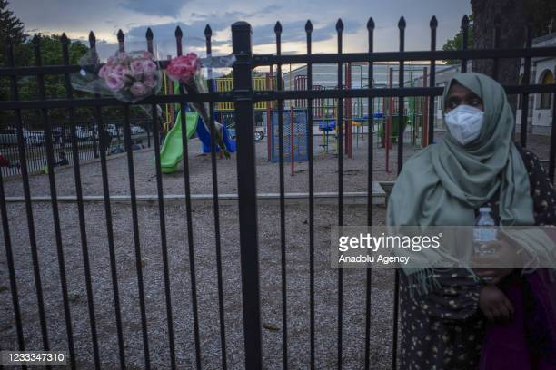 Woman listens to speakers outside the London, Ontario Mosque after a family of five was hit by a driver in London, Ontario, Canada on June 08, 2021....