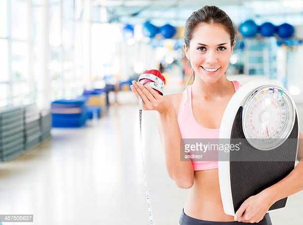 woman living a healthy lifestyle - kilogram stock pictures, royalty-free photos & images