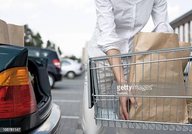 woman loads a car